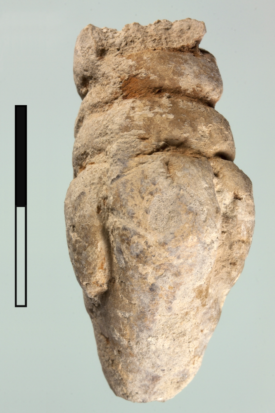 Stylized anthropomorphic clay figurine from a pit in Unit H that post-dates the Meana Horizon.